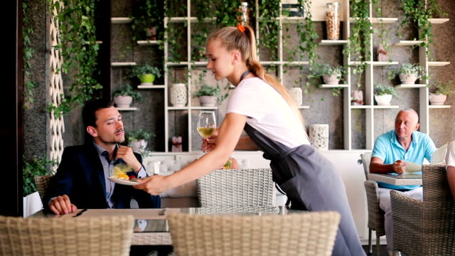 The waiter brings order to the man. video