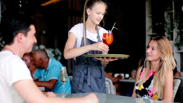 The waitress brought two glasses to pair. video