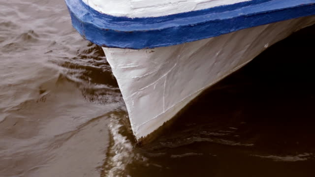 The water beats against the bow of the boat video