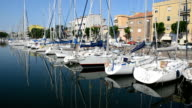 The water channel with parked sail yachts, Rimini, Italy video