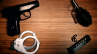 The weapon lies on the table: a cannon, a grenade, handcuffs, clips, bullets video