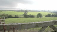 The Welsh Countryside Through Old Wooden Gate video