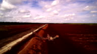 The wide peat field with brown soils on it video