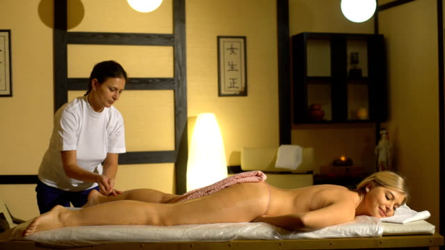 the woman doing the massage of the buttocks video