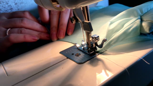 The woman finishes work on the sewing machine. video