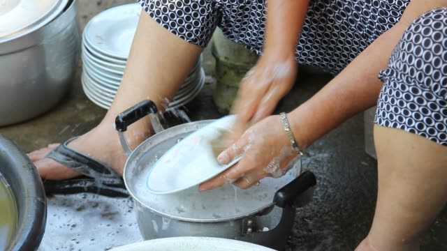 The woman washing a dish video