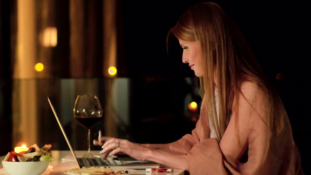 The writer smokes and writes a new chapter of her novella on terrace of the villa video