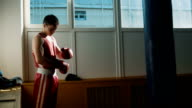 The young boxer training hitting the punching bag video