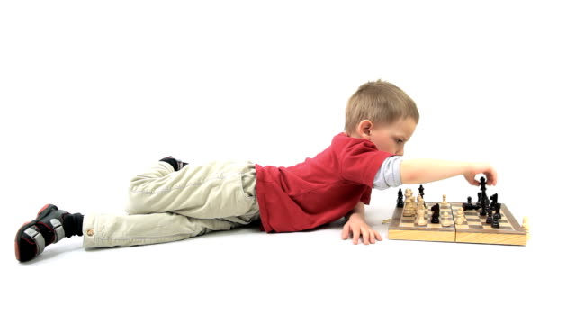 The young boy playing chess. Little genius. video