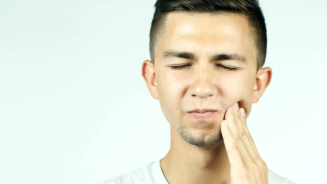The young guy toothache, toothache video