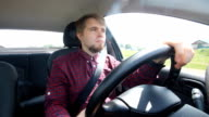 The young man behind the wheel happy video