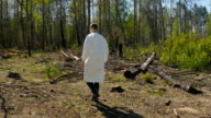 The young man walking through the felling video