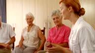 Therapist talking to senior people video