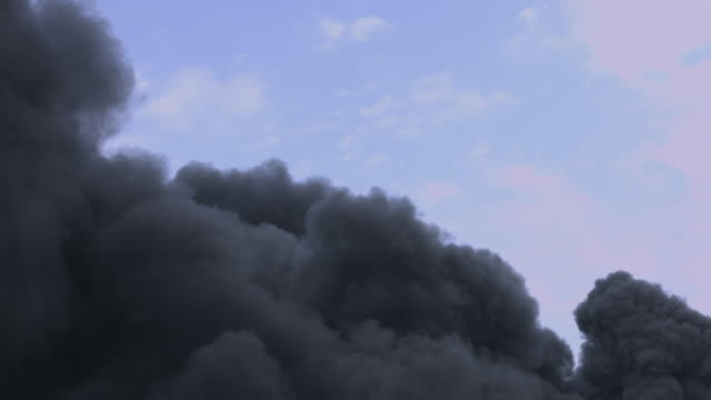 Thick black fire smoke polluting the air. video