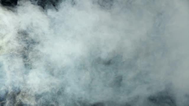 Thick smoke on black background video