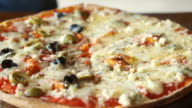 Thin crispy Italian pizza with two face half and half topping video