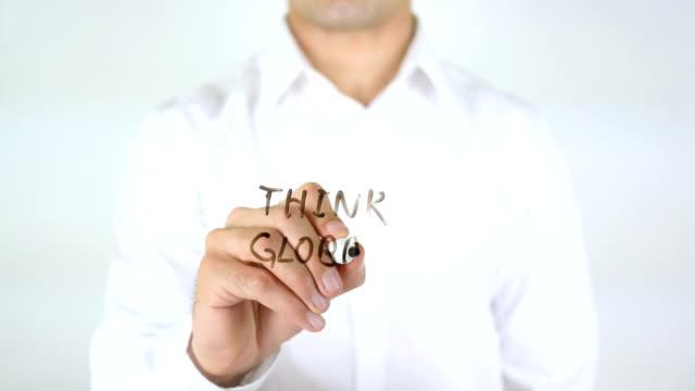 Think Global, Man Writing on Glass video