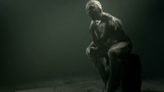 Thinking man, inspired by Rodin zoom in. video