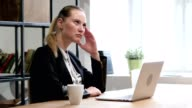 Thinking Woman Working on Laptop in Office video