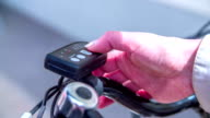 This man is setting up the electric bicycle because they want to discover a beautiful landscape and surroundings. video