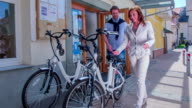 This two young people are preparing to cycling with electric bicycle because they want to discover a beautiful landscape and surroundings. video
