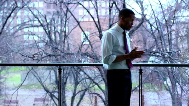 Thoughtful Businessman Looks out Window - WS video