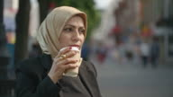 Thoughtful Middle Eastern woman drinking coffee video