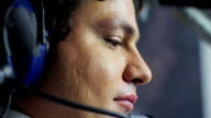 Thoughtful pilot concentrating on flight, hard work and responsibility, job video