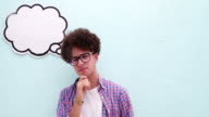 Thoughtful young nerd with thought bubble over head video
