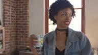 Three adult girlfriends talking in kitchen, panning shot, shot on R3D video