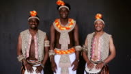 Three African mans smiles broadly video