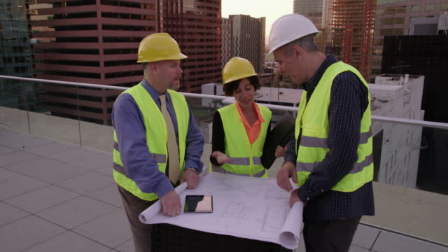 Three architects look over plans video