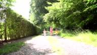 Three Asian Children Running Towards Camera On Summer Path video