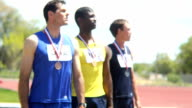 Three athletes with medals video