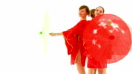 Three beautiful European girls in Chinese national costumes with umbrellas. video