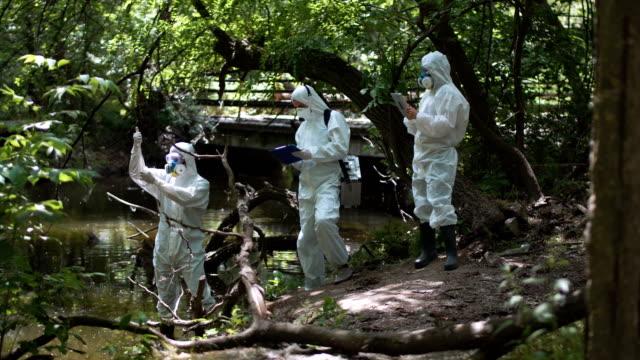 Three bio technicians testing for pollutants video