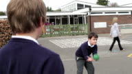 Three Boys Playing Catch In School Playground video