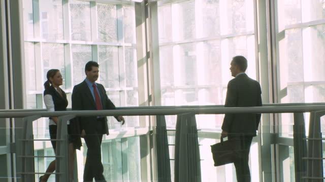 Three business people meet 2 video