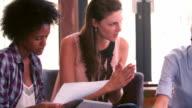 Three Businesswomen Having Informal Meeting In Office video