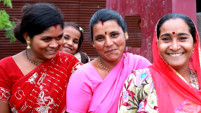 Three cheerful traditional Indian Women with a Girl video