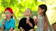 Three children have fun eating ice cream video