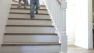 Three Children Running Down Stairs At Home video