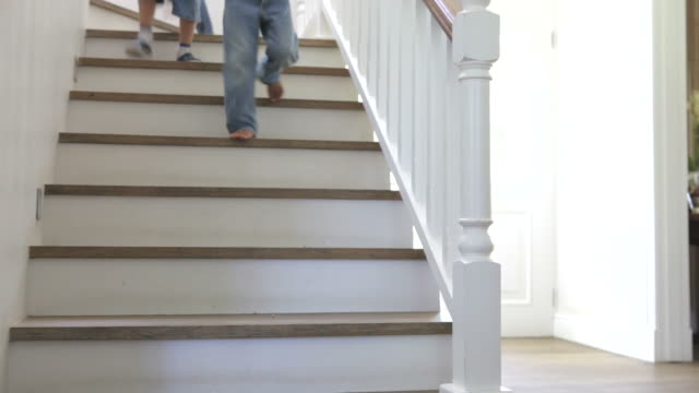 Three Children Running Down Stairs At Home video
