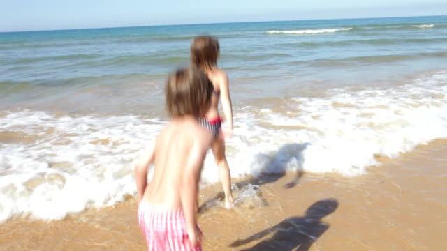 Three Children Splashing In the Sea video