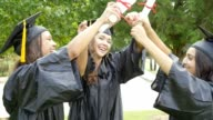 Three college friends celebrate after graduation video