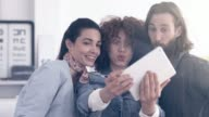Three creative people making a selfie at the office video