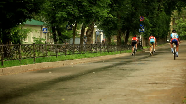 Three cyclists racing in the street video