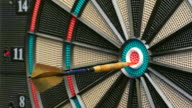 Three darts hit the double bullseye in rapid succession. video