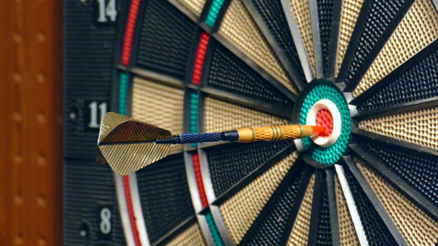 Three Darts Hitting the Double Bullseye, Slow Motion. video