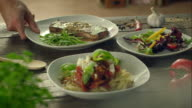 Three different meals on a table video